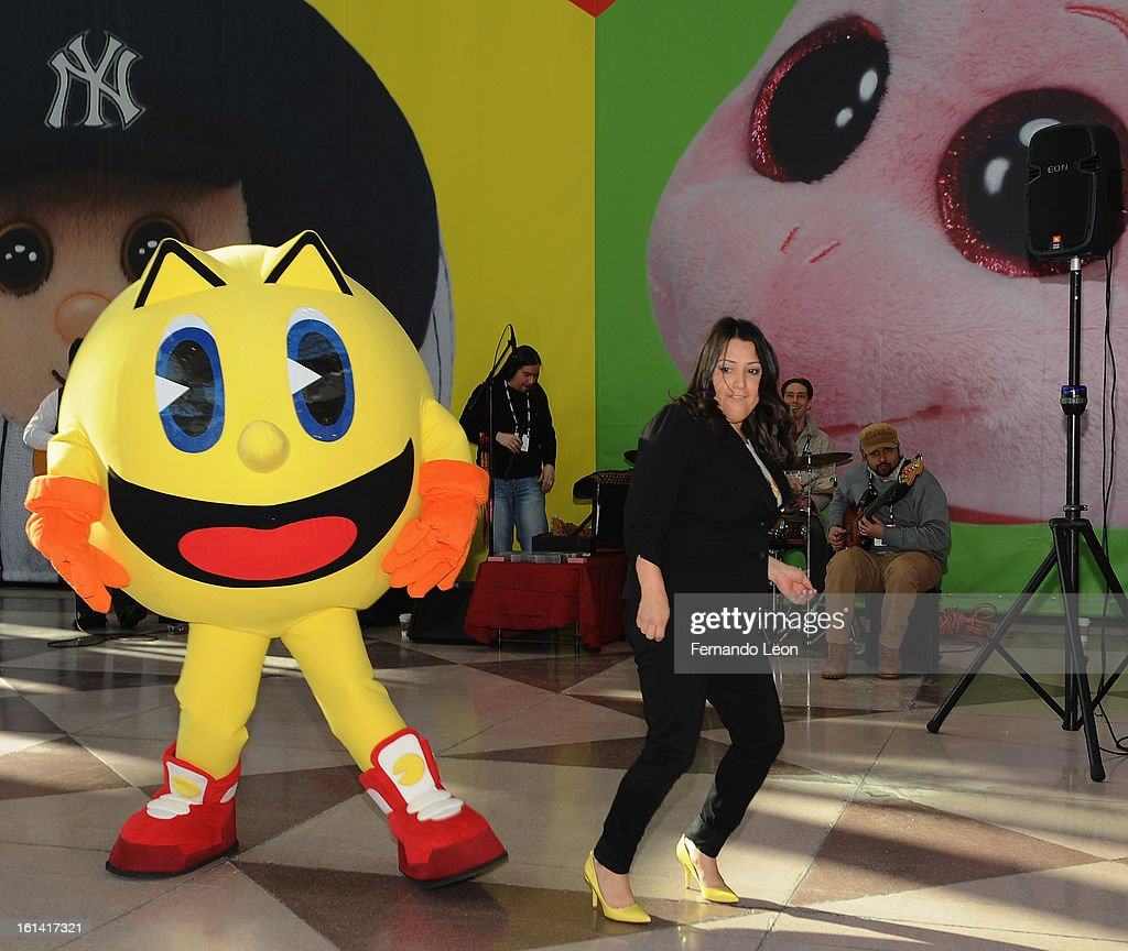 Pac-Man and Pac-Man Brand Manager Veronica Sandoval (R) join opening ceremonies at Toy Fair to celebrate the launch of new Pac-Man Toys from Bandai of America, based on the upcoming Disney XD animated series 'PAC-MAN and the Ghostly Adventures'>> at Jacob Javitz Center on February 10, 2013 in New York City.