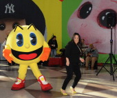 PacMan and PacMan Brand Manager Veronica Sandoval join opening ceremonies at Toy Fair to celebrate the launch of new PacMan Toys from Bandai of...