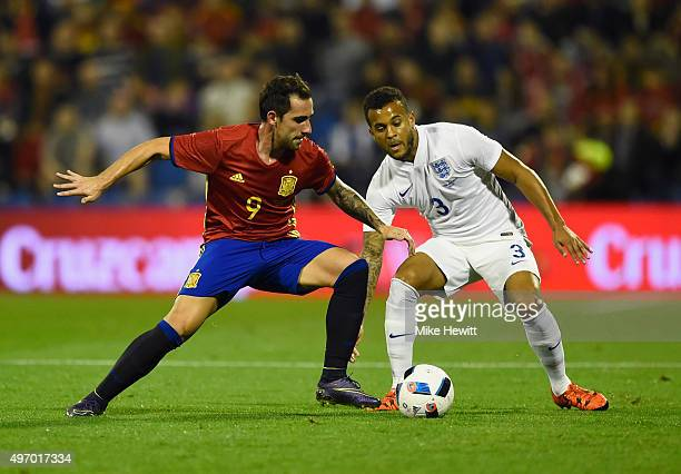 Paco Alcacer Garcia of Spain is watched by Ryan Bertrand of England during the international friendly match between Spain and England at Jose Rico...