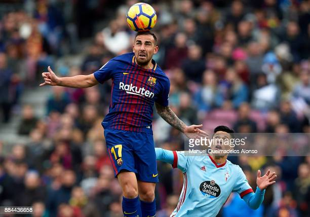 Paco Alcacer of Barcelona competes for the ball with Facundo Roncaglia of Celta during the La Liga match between Barcelona and Celta de Vigo at Camp...