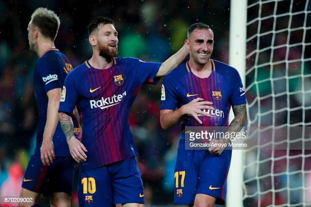 Paco Alcacer of FC Barcelona celebrates scoring their opening goal with teammate Lionel Messi during the La Liga match between FC Barcelona and...