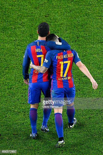 Paco Alcacer of FC Barcelona celebrates with his team mate Ardan Turan after scoring his team's fifth goal during the Copa del Rey round of 32 second...