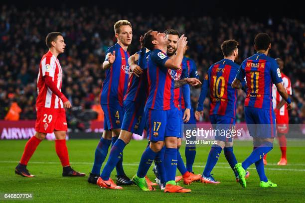 Paco Alcacer of FC Barcelona celebrates with his team mates after scoring his team's fourth goal during the La Liga match between FC Barcelona and...