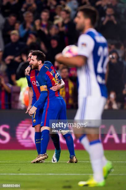 Paco Alcacer of FC Barcelona celebrates with his teammate Lionel Messi after scoring his team's third goal during the La Liga match between FC...