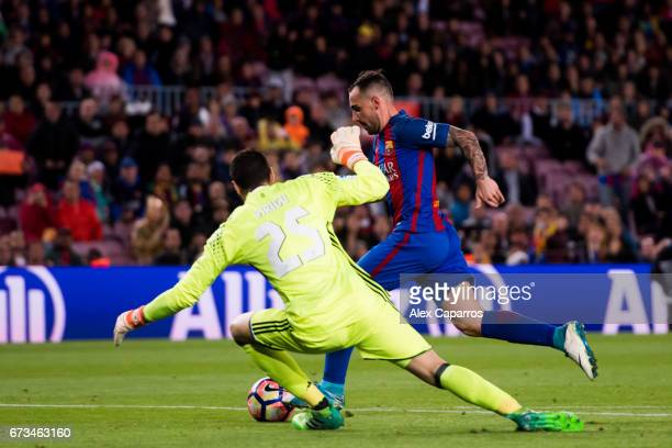 Paco Alcacer of FC Barcelona dribbles Salvatore Sirigu of CA Osasuna to score his team's seventh goal during the La Liga match between FC Barcelona...