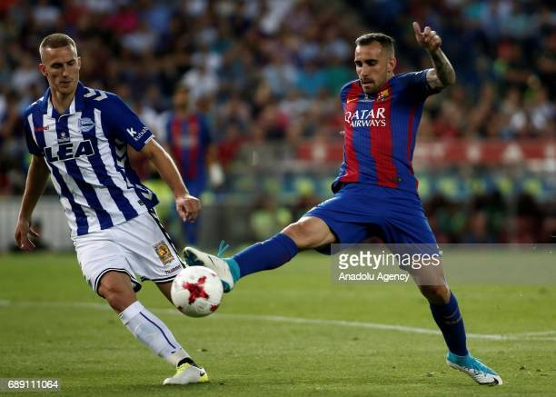 Paco Alcacer of FC Barcelona in action against Rodrigo Ely during the Copa Del Rey Final between FC Barcelona and Deportivo Alaves at Vicente...
