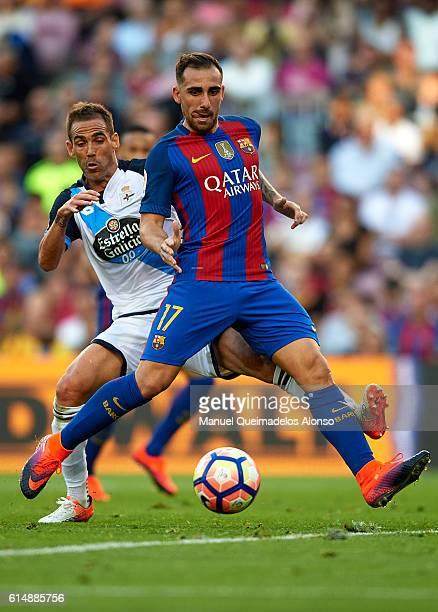 Paco Alcacer of FC Barcelona is tackled by Fernando Navarro of Deportivo de La Coruna during the La Liga match between FC Barcelona and RC Deportivo...