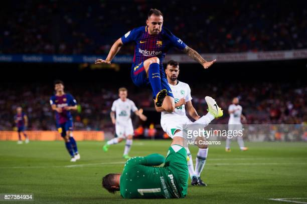 Paco Alcacer of FC Barcelona jumps over Artur Moraes of Chapecoense during the Joan Gamper Trophy match between FC Barcelona and Chapecoense at Camp...