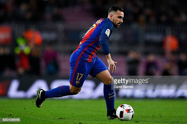Paco Alcacer of FC Barcelona runs with the ball during the Copa del Rey round of 32 second leg match between FC Barcelona and Hercules at Camp Nou on...