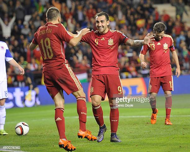 Paco Alcacer of Spain celebrates with Jordi Alba after scoring his team's 3rd goal during the UEFA EURO 2016 Qualifier group C match between Spain...
