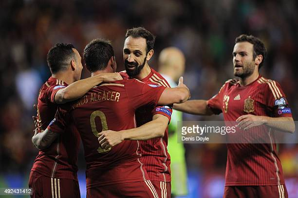 Paco Alcacer of Spain celebrates with Juanfran after scoring his team's 3rd goal during the UEFA EURO 2016 Qualifier group C match between Spain and...