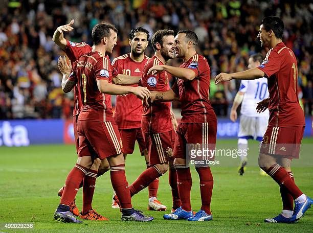 Paco Alcacer of Spain celebrates with teammates after scoring his team's 3rd goal during the UEFA EURO 2016 Qualifier group C match between Spain and...