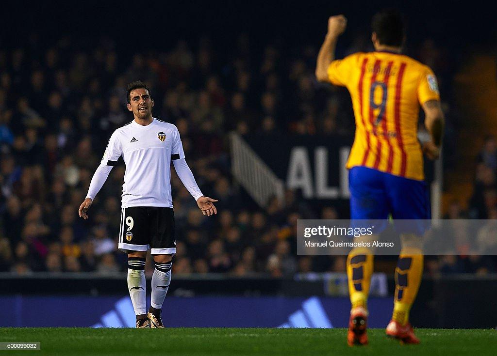 Paco Alcacer (9) of Valencia reacts to Luis Suarez of Barcelona during the La Liga match between Valencia CF and FC Barcelona at Estadi de Mestalla on December 05, 2015 in Valencia, Spain.