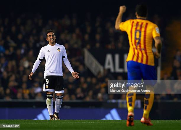 Paco Alcacer of Valencia reacts to Luis Suarez of Barcelona during the La Liga match between Valencia CF and FC Barcelona at Estadi de Mestalla on...