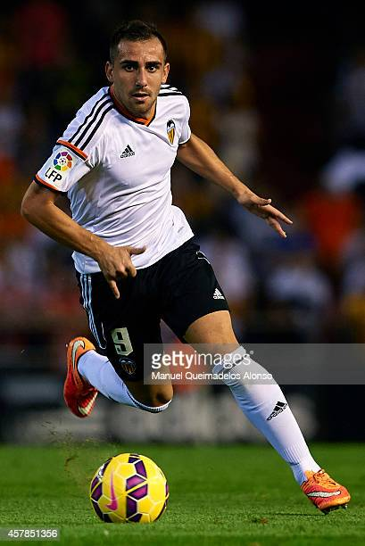 Paco Alcacer of Valencia runs with the ball during the La Liga match between Valencia CF and Elche CF at Estadio Mestalla on October 25 2014 in...