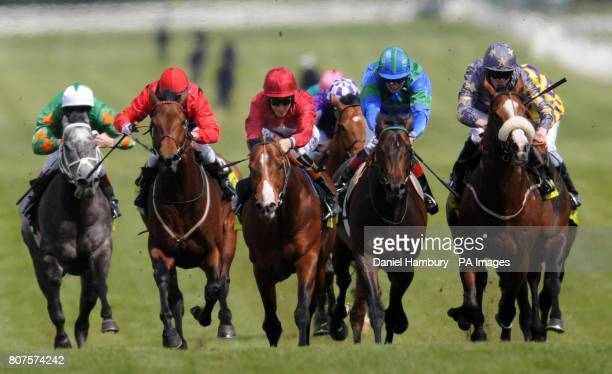 Paco Boy ridden by Richard Hughes goes on to win the totesportcom Lockinge Stakes at Newbury Racecourse