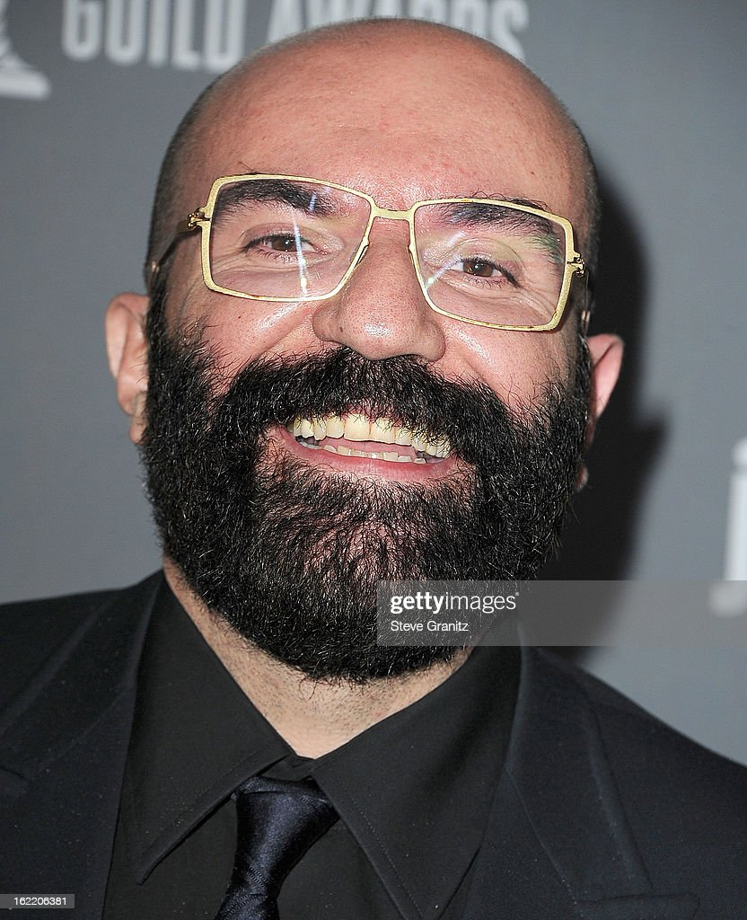 Paco Delgado arrive at the 15th Annual Costume Designers Guild Awards at The Beverly Hilton Hotel on February 19, 2013 in Beverly Hills, California.