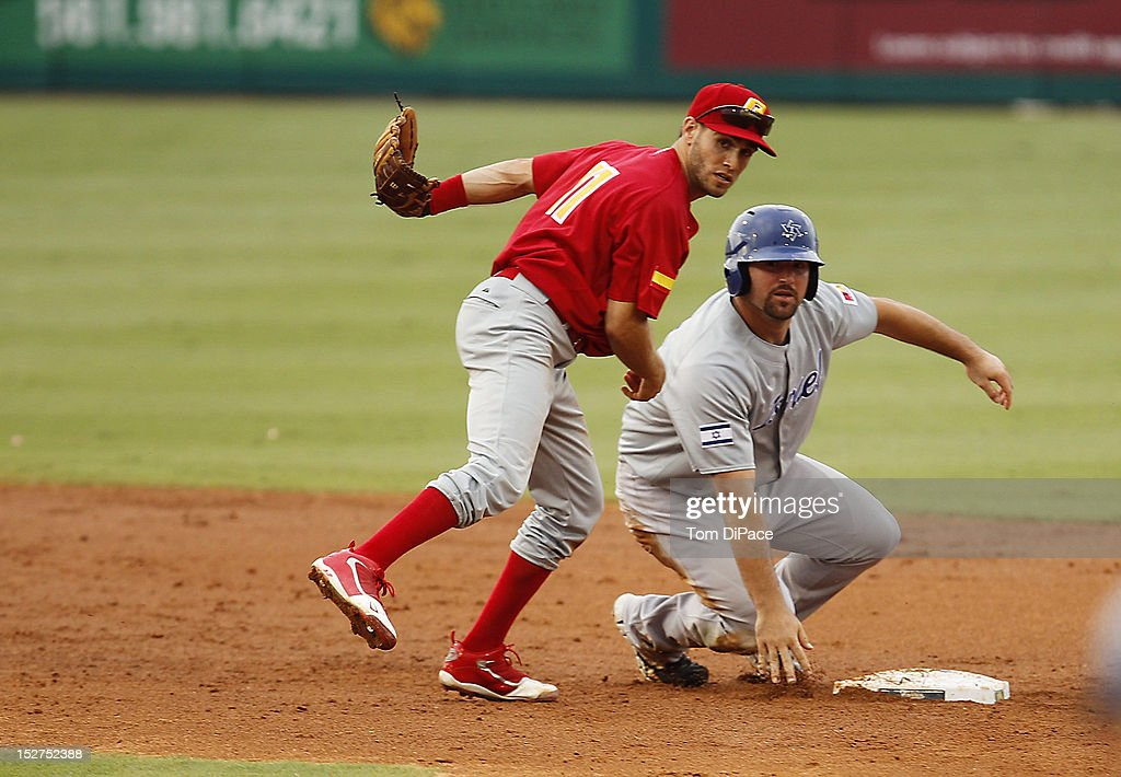 Paco Figueroa #11 of Team Spain attempts to turn a double play as Cody Decker #6 of Team Israel slides into second base during game 6 of the Qualifying Round of the World Baseball Classic at Roger Dean Stadium between Team Israel and Team Spain on September 23, 2012 in Jupiter, Florida.