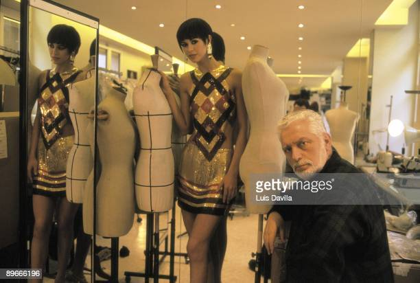 Paco Rabanne at his studio in Paris The fashion designer beside a model who wears one of his designs
