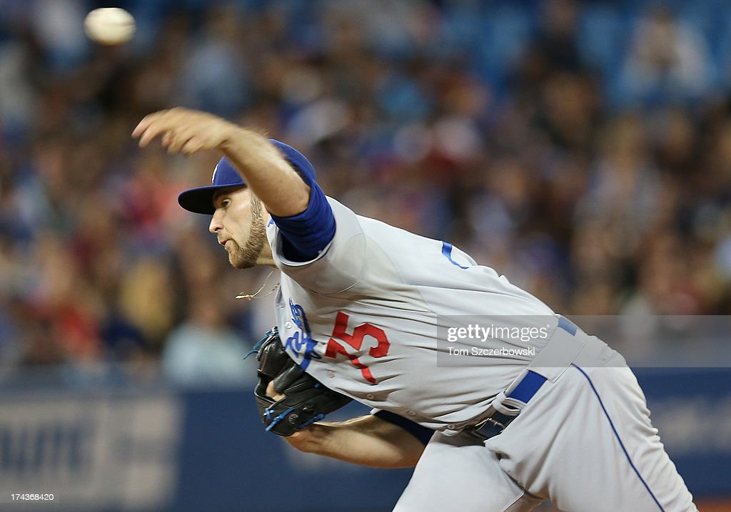 Paco Rodriguez #75 of the Los Angeles Dodgers delivers a pitch during MLB game action against the Toronto Blue Jays on July 24, 2013 at Rogers Centre in Toronto, Ontario, Canada.