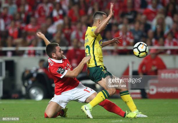 Pacos de Ferreira defender Francisco Afonso from Portugal with SL Benfica forward Andrija Zivkovic from Serbia in action during the Primeira Liga...