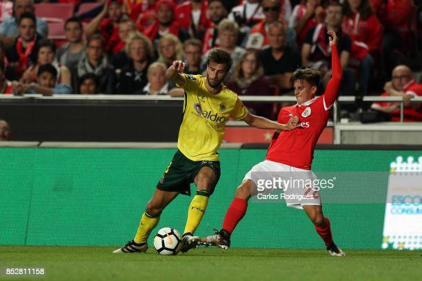 Pacos de Ferreira defender Rui Correia from Portugal vies with Benfica's forward Franco Cervi from Argentina for the ball possession during the match...