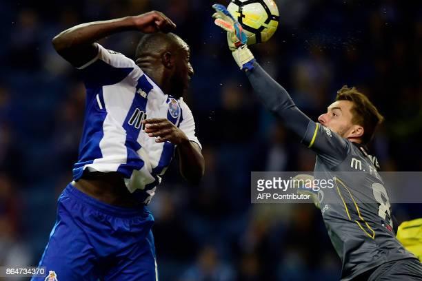 Pacos de Ferreira's goalkeeper Mario Felgueiras blocks a header by Porto's Malian forward Moussa Marega during the Portuguese league football match...