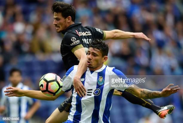 Pacos de Ferreira's midfielder Vasco Rocha vies with Porto's Brazilian forward Soares during the Portuguese league football match FC Porto vs FC...