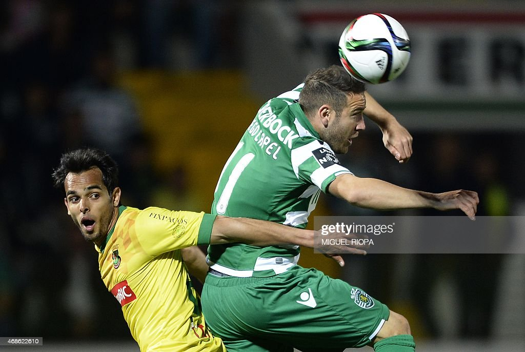 Pacos Ferreira's Brazilian defender Rodrigo Galo (L) jumps for the ball with Sporting's Spanish forward <a gi-track='captionPersonalityLinkClicked' href=/galleries/search?phrase=Diego+Capel&family=editorial&specificpeople=4164836 ng-click='$event.stopPropagation()'>Diego Capel</a> during the Portuguese league football match FC Pacos de Ferreira vs Sporting CP at the Capital do Movel stadium in Pacos de Ferreira on April 4, 2015. The match finished with a 1-1 draw.