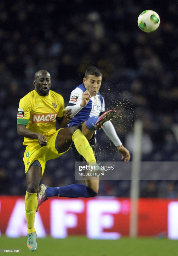 Pacos Ferreira's Guinean forward Cicero Semedo (L) jumps for the ball with Porto's Argentinian defender Nicolas Otamendi during the Portuguese league football match FC Porto vs Pacos Ferreira at the Dragao stadium in Porto on January 19, 2013.