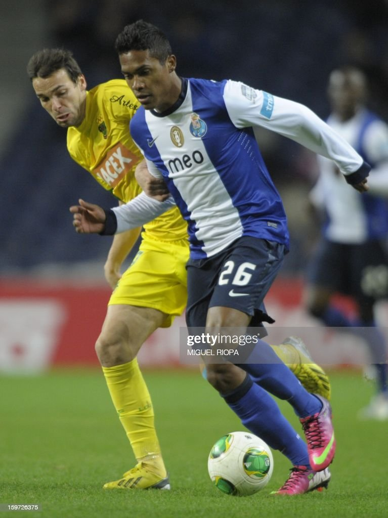 Pacos Ferreira's midfielder Andre Leao (L) vies with Porto's Brazilian defender Alex Sandro during the Portuguese league football match FC Porto vs Pacos Ferreira at the Dragao stadium in Porto on January 19, 2013.