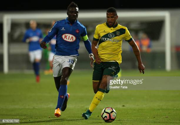 Pacos Ferreira's midfielder Bruno Santos from Brazil with Belenenses's forward Abel Camara from Portugal in action during the Primeira Liga match...