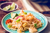Homemade pad thai noodle receipe with prawns, tofu, spring onions, ginger, peanuts and fried egg.