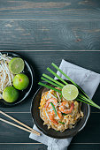 "Thai food background Thai Fried Noodles ""Pad Thai"" with shrimp and vegetables. Thailand's national dishes"