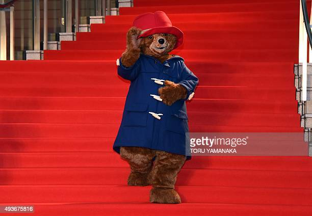 Paddington Bear waves to photographers on the red carpet upon its arrival for the opening ceremony of the 28th Tokyo International Film Festival in...