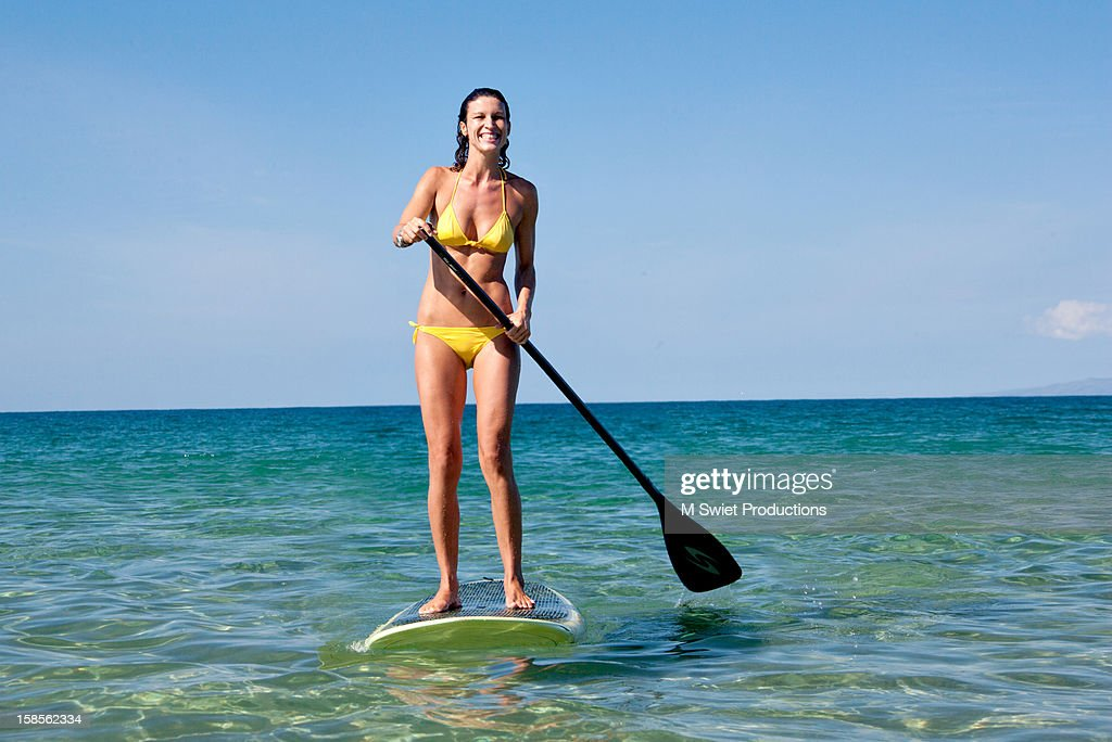 Paddle board woman beach