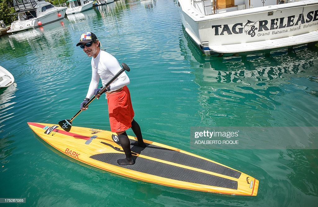 U.S. paddle boarder from Tennessee, Benjamin Schiller Friberg, on his paddle board at Marina Hemingway, on August 1, 2013 in Havana. Schiller will attempt to cross the Florida strait on his paddle board.