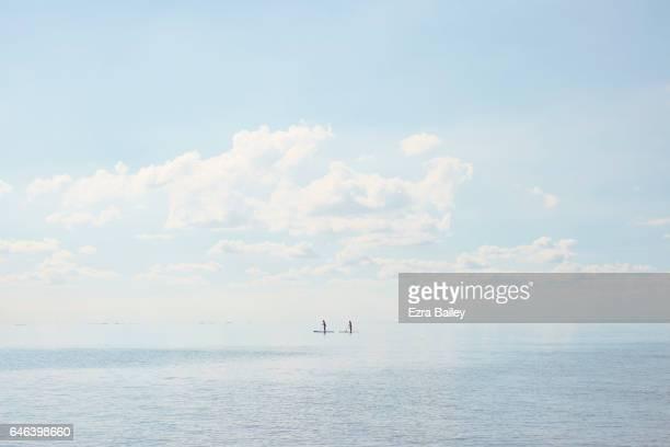 Paddle boarders on a calm sea