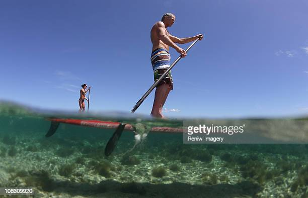 Paddle boarding couple