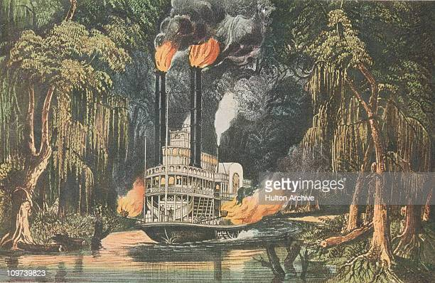 A paddle steamer makes its way through a bayou on the Mississippi River in Louisiana using torchlight to guide the way circa 1860