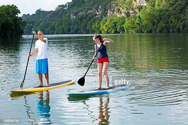paddleboarding  male and female stand up paddling