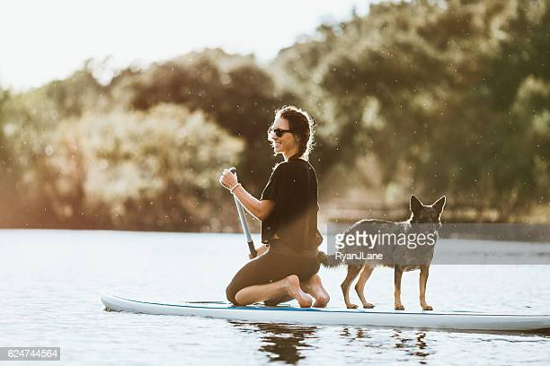 Paddleboarding Woman With Dog