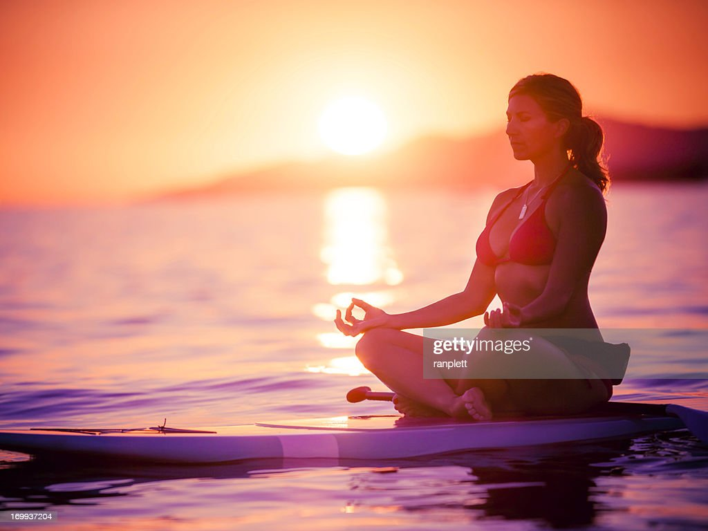 Paddleboarding Yoga : Stock Photo