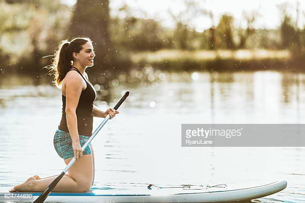 Paddleboarding Young Woman