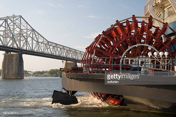 Paddlewheel of a boat about to go under the bridge