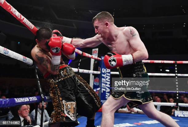 Paddy Barnes and Adrian Dimas Garzon of Argentina during the Frank Warren Championship Boxing bill at the Waterfront Hall on March 10 2017 in Belfast...