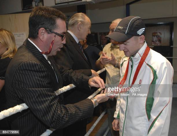 Paddy Barnes the Olympic Bronze Medallist with Dave Boy McCauley who returns to his Boxing club in North Queen Street Belfast to a hero's return...