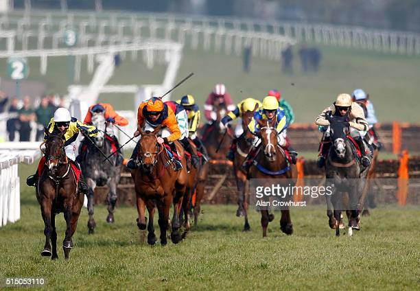 Paddy Brennan riding Barney Dwan clear the last to win The 30th EBF Greenall's Gin 'National Hunt' Novices' Handicap Hurdle Race at Sandown...