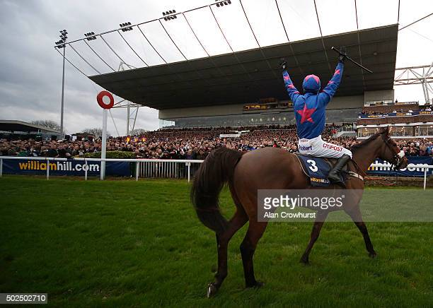 Paddy Brennan riding Cue Card celebrate winning The William Hill King George VI Steeple Chase at Kempton Park racecourse on December 26 2015 in...