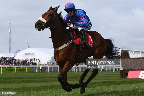 Paddy Brennan riding Cue Card on his way to victory in the Betfred Bowl steeplechase at Aintree Racecourse on April 7 2016 in Liverpool England